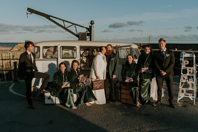 Wedding party in front of the Quirky Camper booth Northern Ireland